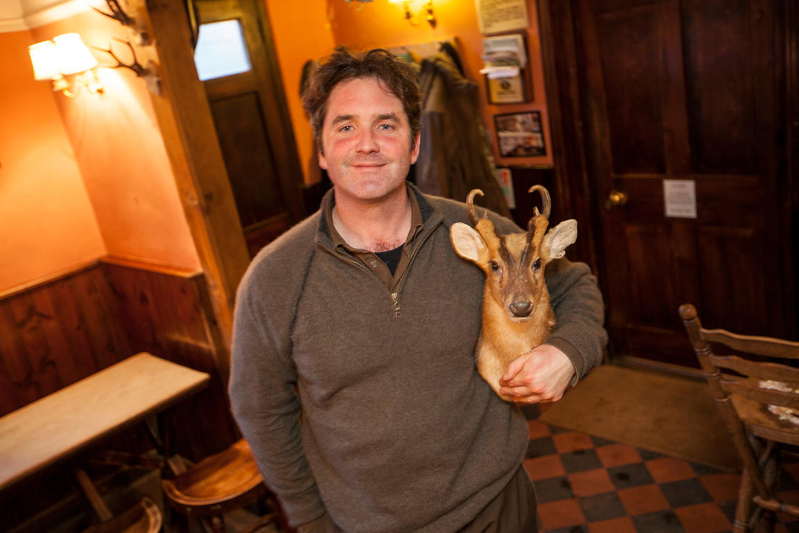 UK - Berkshire - Mike Robinson, chef and restauranteur at his pub, the Potkiln with a stuffed Muntjac head that hangs over the bar