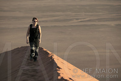 Woman walking on dune