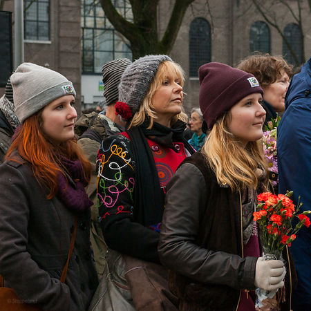 Young women with a bunch of flowers
