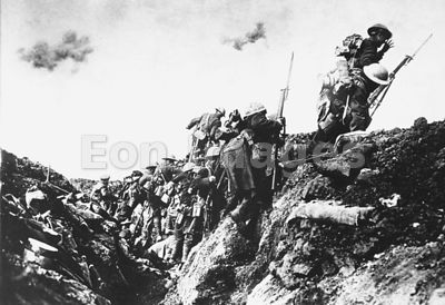 Canadian troops go over the top of trench in France