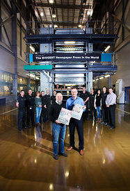 Newsprinters, News International Print Plant, Eurocentral, Scotland..January 2013.Pictured are George Donaldson (black jumper), Group Continuous Improvement Manager and Ross McCombe (blue shirt), Operations Manager with staff in the plant..Free First Use for Findlay Media...Picture Copyright:.Iain McLean,.79 Earlspark Avenue,.Glasgow.G43 2HE.07901 604 365.photomclean@googlemail.com.www.iainmclean.com.All Rights Reserved.No Syndication