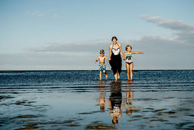 Young Nordic woman and children in the water 4
