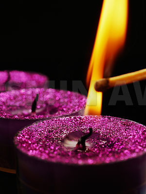 Lighting a pink glitter candle Shallow DOF