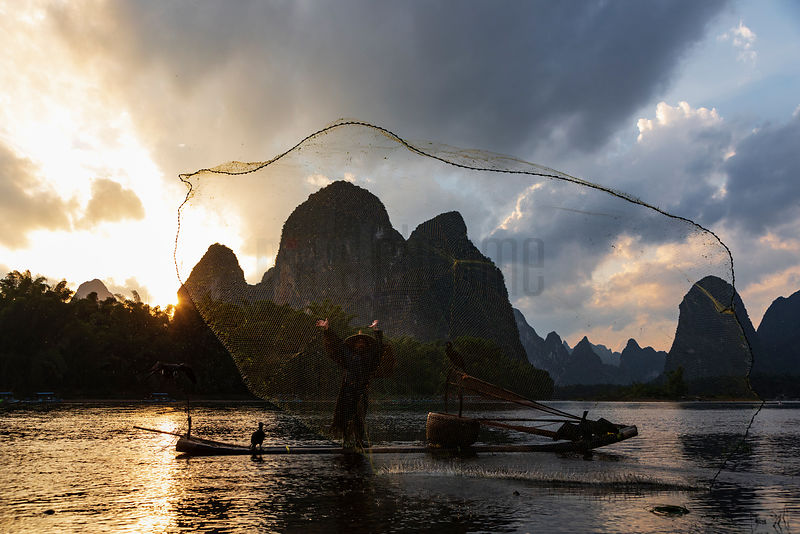 Cormorant Fisherman Throwing a Seina Net into the Li River