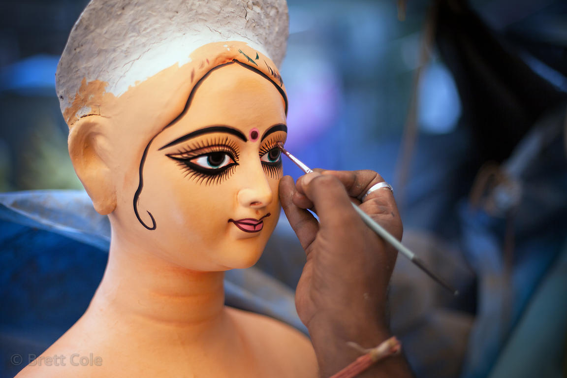Eyes are painted on a Durga Puja idol at a workshop in Kumartoli (Potter's Town), Kolkata, India. The idols are said to come alive when the eyes are painted.