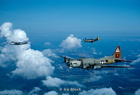 A B-17flying along with a B-24 and a P-51 Mustang