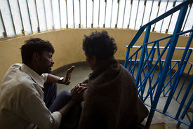 India - Delhi - Khushi Ram, a worker for Aashray Adhikar Abhiyan counsels Kulbahadur a former drug addict that has been treated for schizophrenia