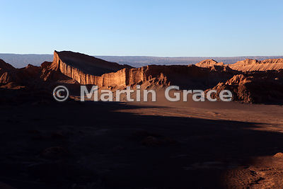 View across the Amphitheatre of the Valley of the Moon from Duna Mayor as the sun is setting, Atacama, Region ll Antofagasta, Chile