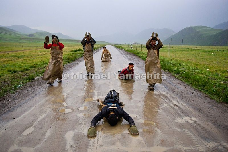 Devout pilgrims proceed at a snail's pace performing the Chak Tsal, the Tibetan name for ritual prostration. Their journey from Qinghai will take six months, along the northern branch of the Tea Horse Road to the sacred city of Lhasa.