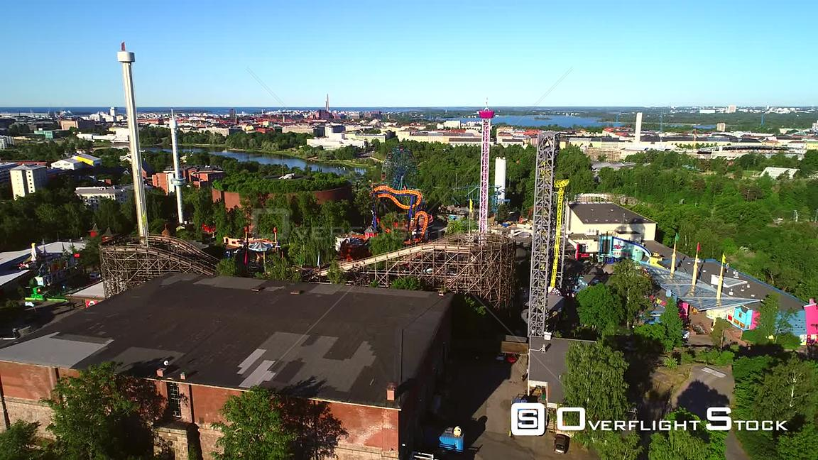 Linnanmaki, Aerial Rising Tilt View of the Helsinki Amusement Park, on a Sunny Summer Morning Dawn, in Helsingfors, Uusimaa, Finland