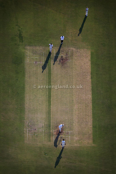 aerial photograph  of Ramsbottom Cricket Club Lancashire England UK, playing cricket on a sunny summers evening.