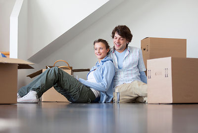 Couple sitting with cardboard boxes