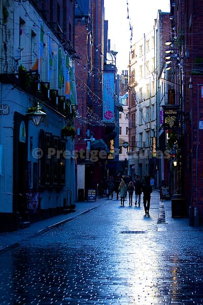 Passersby Walking Through the world famous Mathew Street on a Rainy Day