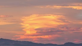 Medium Shot: Sunset Over Rare Sierra Lenticular Wave