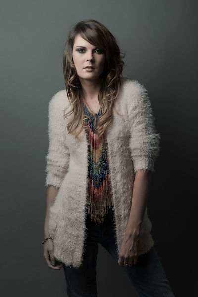 Fashion shoot with Jen Ward with long coloured necklace. Done in the studio with make up by Natalie Greenwell