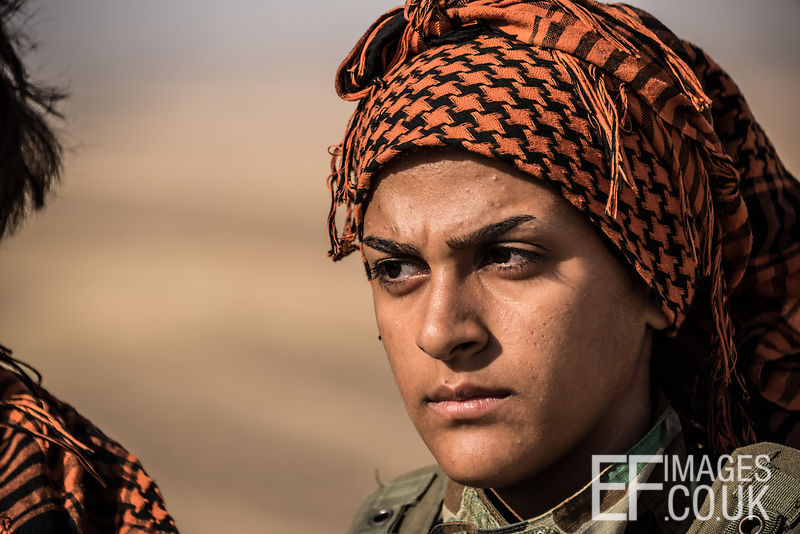 PAK (Kurdistan Freedom Party) female fighter at her base north of Hawija, where Kurdish Iranian fighters are holding the line against the last vestiges of Daesh and preparing to engage the Hashd al Shaabi forces threatening Kirkuk. Kirkuk Governorate, Iraq, 14th October 2017