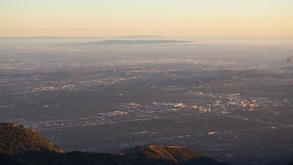 Bird's Eye: Dolly Of The Entire Los Angeles Basin During A Stark Transition From Day To Night