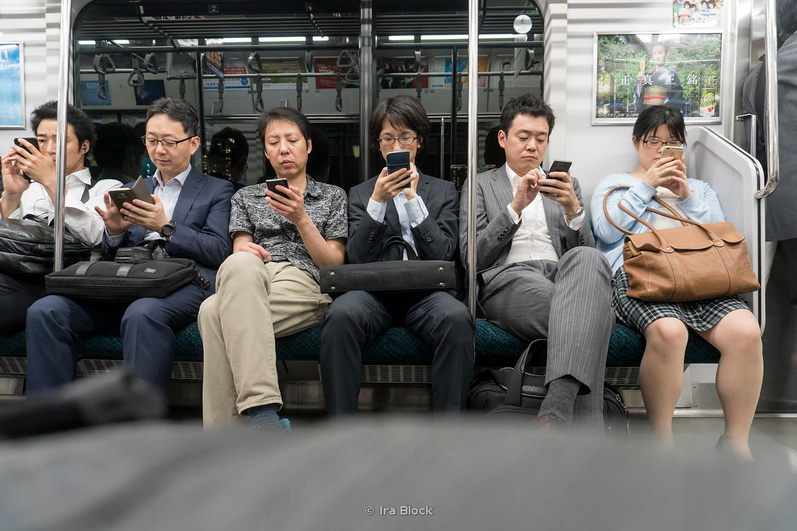 People with cell phones in a train in Tokyo, Japan.
