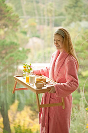 woman holding breakfast tray