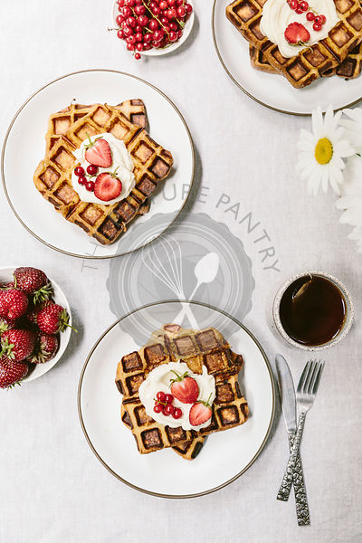breakfast waffles topped off with creme fraiche and summer berries