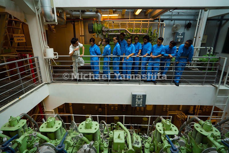 Year 1 Marine Engineering students query lecturer Mr. Ng Guo Yi on the finer aspects of maintaining the ship's engine in ship-shape form. A bird's eye view shows the engine simulator roaring into life, providing the students with a realistic training platform.
