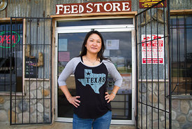 Nai Lam, owner of Midway Package, in front of her new feed store in Berryville, Texas