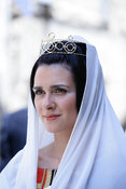 woman wearing mediaeval costume including head dress and tiara