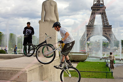 Stunt Cyclist Mounting a Plinth by the Palais de Chaillot