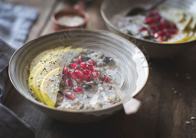 Seeded oatmeal (hemp, flax, chia, sunflower seed) with pear and pomegranate