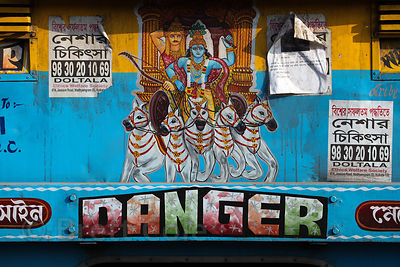 Hindu idols on the back of a bus in Kolkata, India.