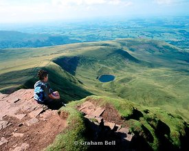 boy on summit of corn du brecon beacons wales