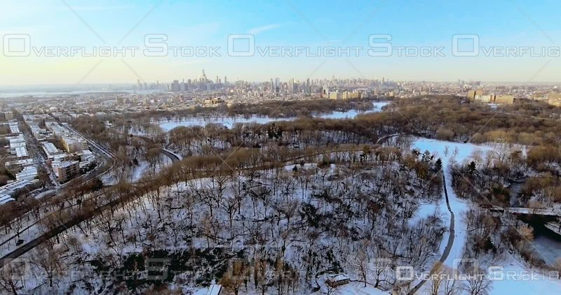 Aerial Rises Over Prospect Park Snow Brooklyn Manhattan in Background NYC