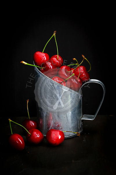Cherries in a Vintage Measuring Can