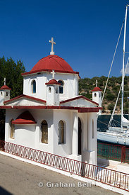 Small Chapel besides harbour, Vathi, Meganisi Island Lefaks, Ionian Isalnds, Greece.