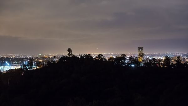 Medium Shot: Panning L.A. Neighborhoods, Hills, & Streets At Night
