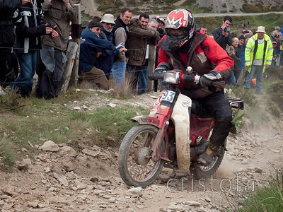 an ambitious rider tackles the steep Blue Hills section Land's End Trials on a Honda C90