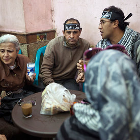 Protesters who have come from a rally in Tahrir Square talk and rest at the Zahrat al-Bustan cafe, Cairo