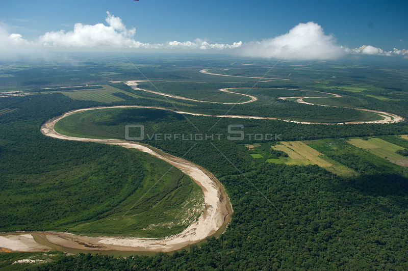 Aerial view of Ichilo River flowing through agricultural and rainforest land, Santa Cruz Department, Bolivia.