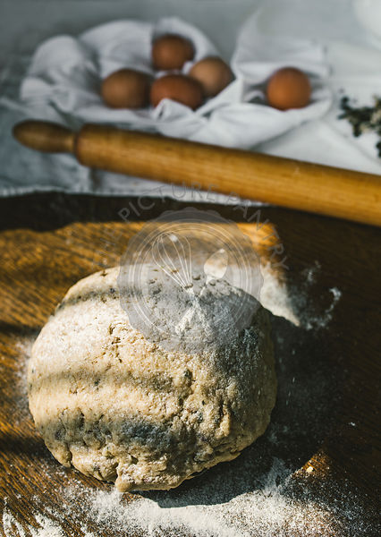 Woman Preparing Homemade Dough in the Kitchen with Mincing Machine. Preparation Raw Dough for Baking