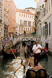 Gondola on a canal in Venice 8