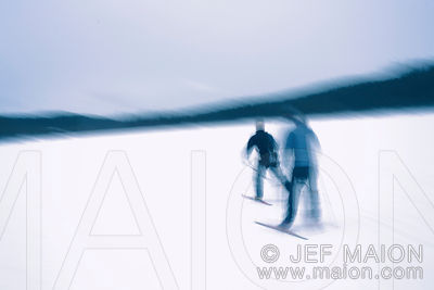 Cross-country skiers on frozen lake