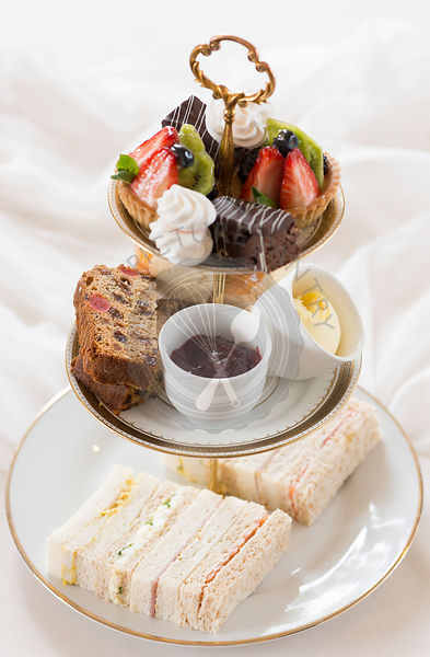 Afternoon tea with cakes, scones and finger sandwiches.
