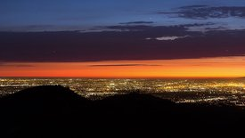 Bird's Eye: Airplanes Like Fireflies Over L.A. In Front Of A Golden Sunset