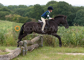 Young pony club rider on his pony