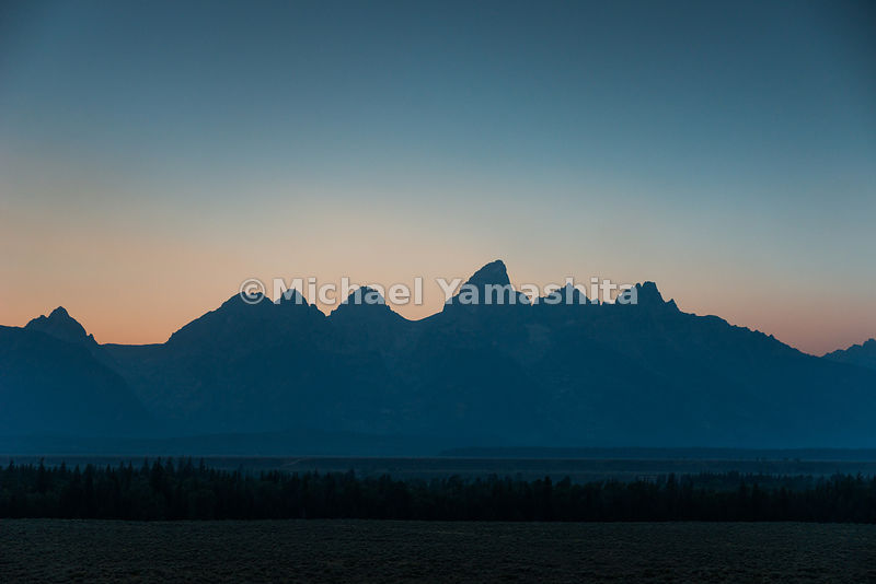 Sunset along Teton Park Road. Grand Teton National Park, Wyoming...Jagged peaks of the Teton Range, lush meadows, dense forests and deep lakes, define this Park, which also teems with wildlife. Highest peak is 13,770ft., park encompasses 485sq. miles.