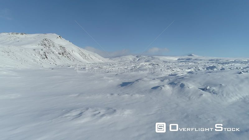 Flying Low Over Snow Covered Mountain Lava Field Iceland Aerial