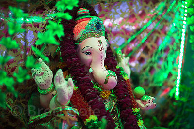 Statue of Ganesh on an altar in Paharganj, Delhi, India