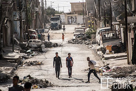 Residents return to their homes in Al Kanisa, West Mosul and begin to contemplate the task of rebuilding their streets. June 2017