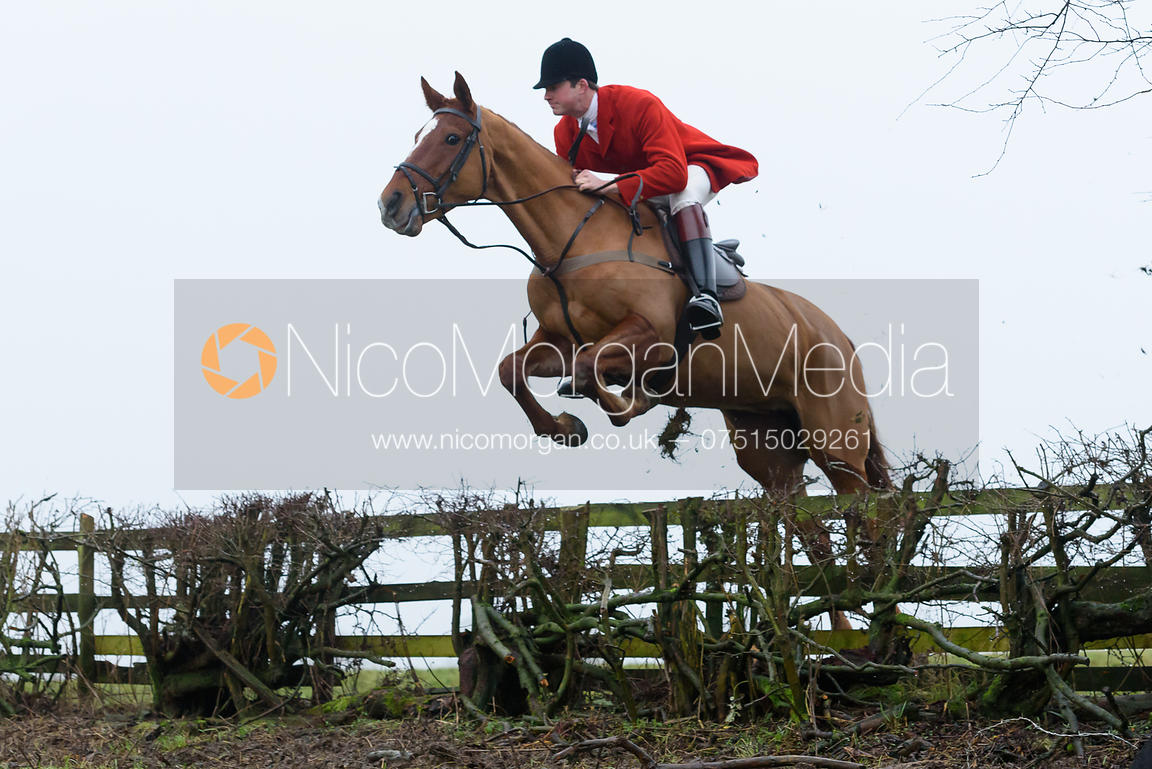 William Bell jumping a hedge above Withcote