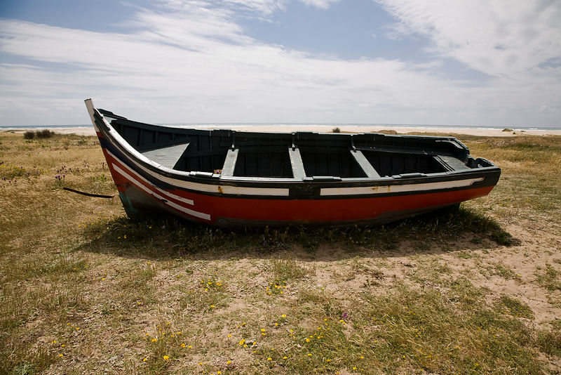 Abandonded boat on the sand dunes